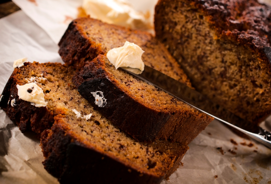 Homemade banana bread and butter.Selective focus on the butter and bread
